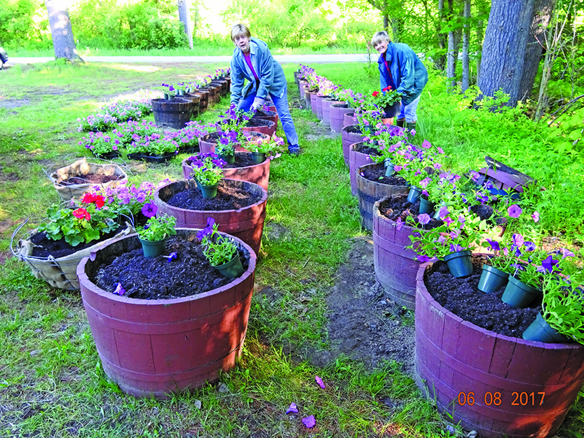 Speculator garden club thanks community for support with flower barrels