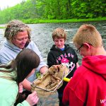 Wells Central School students catch critters on the Sacandaga riverbank